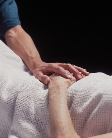 healer: the hand of a healer comforts a patient