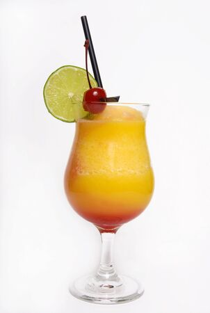 a tropical Hawaiian rum drink with a garnish of lime and cherry