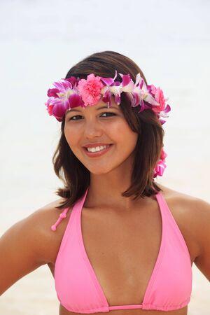 Portrait of a Polynesian girl with flower lei in a pink bikini photo