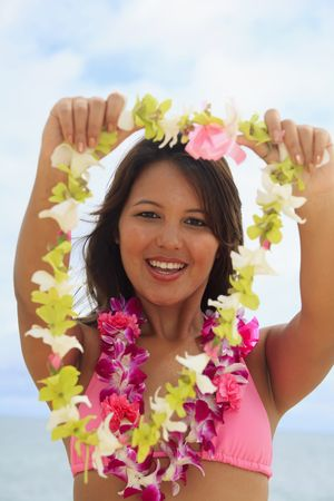 Polynesian girl offering a flower lei Stock Photo