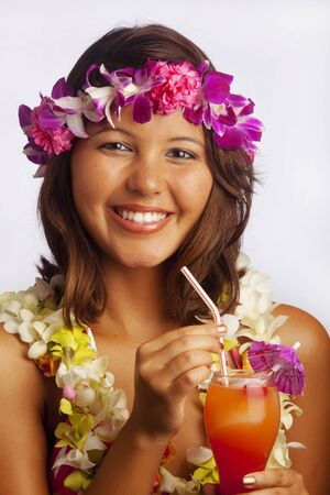 portrait of a Hawaiian girl with flower lei and a tropical drink photo
