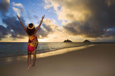 woman doing hula at sunrise at lanikai