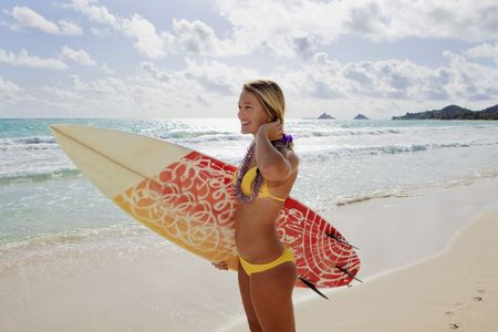 beautiful young girl with surfboard at kailua beach, hawaii photo