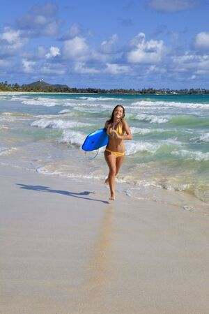 beautiful teenage girl with boogieboard at kailua beach, hawaii photo