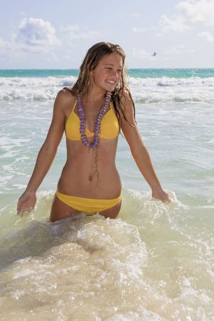 beautiful teenager in a yellow bikini at kailua beach, hawaii Standard-Bild