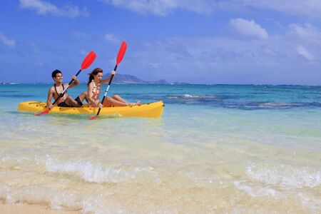 young couple kayaking in hawaii Stock Photo - 6714156