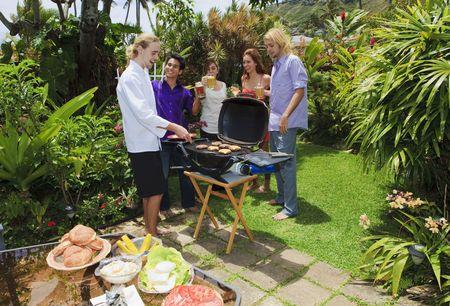 backyard woman: friends at a backyard bar-b-que in hawaii