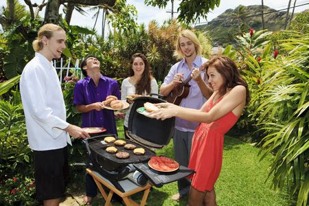 friends at a backyard bar-b-que in hawaii