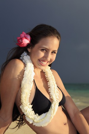 beautiful young woman on lanikai beach at sunrise Stock Photo