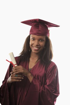 female college graduate in cap and gown with diploma Stock Photo - 7284227