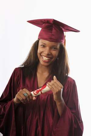 female college graduate in cap and gown with diploma Stock Photo - 7284219
