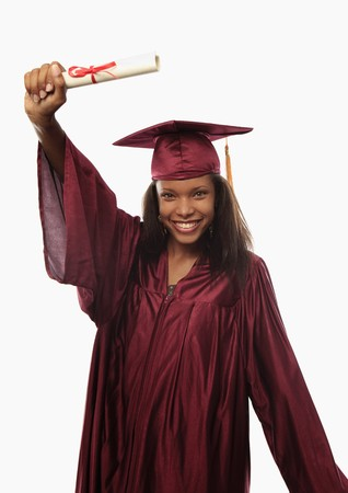 cap and gown: female college graduate in cap and gown with diploma