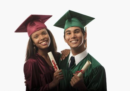 multi racial couple in cap and gown with diploma at graduation photo
