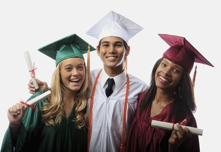 three graduates in cap and gown with diplomas Stock Photo - 7300753