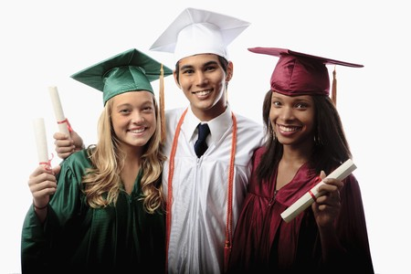 three graduates in cap and gown with diplomas Stock Photo