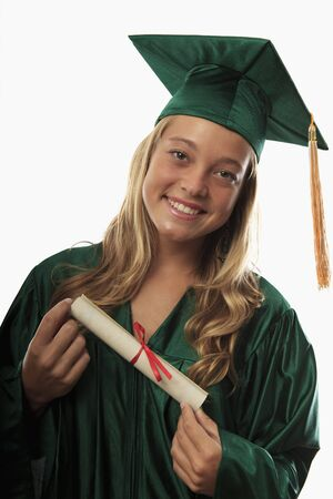 female graduate in cap and gown with diploma Stock Photo - 7300756
