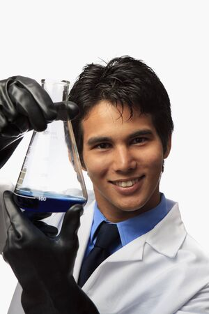 lab technician holding a flask  Stock fotó