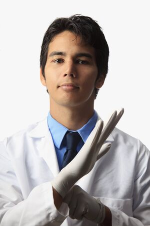 lab technician putting on his gloves Stock Photo - 7413561