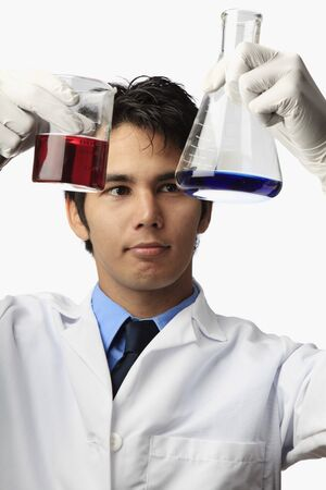 lab technician with beaker and flask