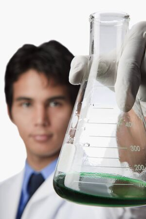 lab technician holding a flask  photo