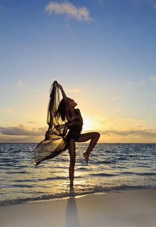 black female dancer standing in the ocean  photo