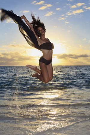 beautiful black female dancer leaping in air  photo