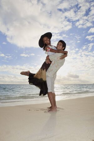 mixed race couple at the beach in hawaii  photo