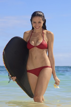 woman at the beach with her boogie board photo