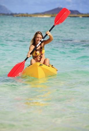 pretty teenage girl with her kayak Stock Photo