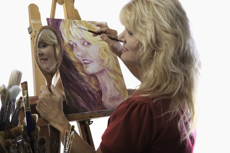 female artist in her fifties paints self portrait Stock Photo - 7803280