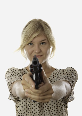 young woman aiming a revolver Stock Photo - 7828188