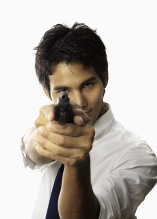 young asian man with automatic pistol photo