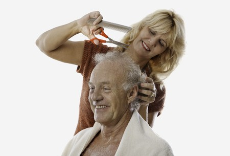 haircut: blond woman cutting the hair of her man