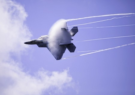 supersonic transport: F-22 Raptor in flight over Hawaii Stock Photo