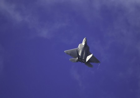 raptor: F-22 Raptor in flight over Hawaii Stock Photo