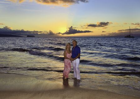 senior couple walking on a maui beach  photo