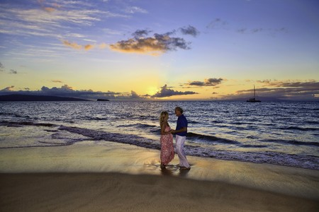 maui: senior couple walking on a maui beach
