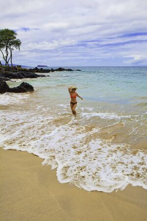 beautiful older woman at the beach in maui photo