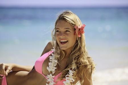 girl in bikini at a Hawaii beach with surfboard