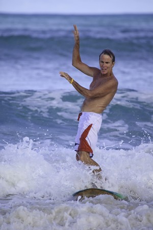 sixty-four year old man surfing in hawaii