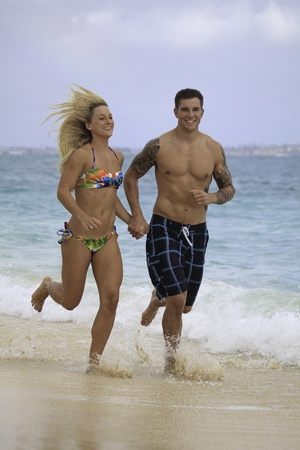 newly wed couple at the beach in Hawaii photo