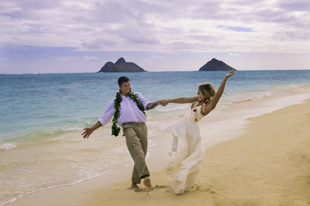 newly wed couple on the beach in Hawaii