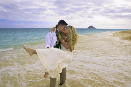 newly wed couple on the beach in Hawaii photo