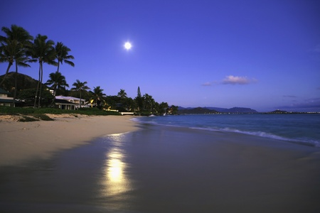 full moon at daybreak on a Hawaii beach