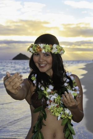 woman dancing hula by the ocean in hawaii Stock Photo