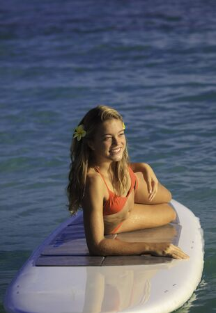 teenage girl on a stand up paddle board  photo