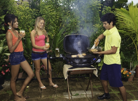 three friends at a barbecue party in hawaii Stock Photo - 8828253