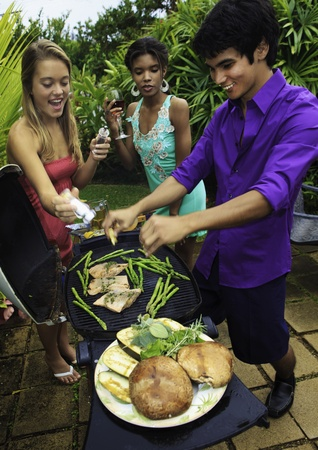 three friends at a barbecue party in hawaii photo