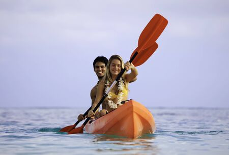 young couple with their kayak in hawaii Stock Photo - 9027356