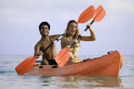 young couple with their kayak in hawaii photo